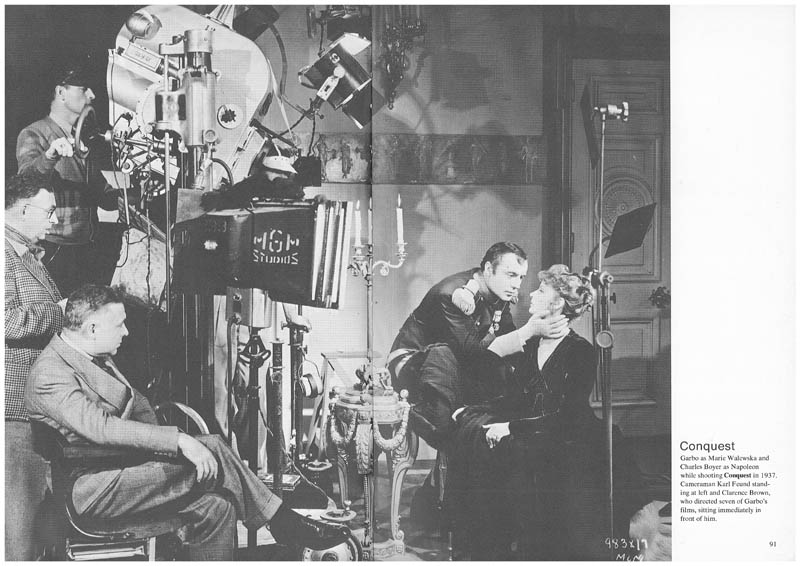 Conquest: Garbo as Marie Walewska and Charles Boyer as Napoleon while shooting Conquest in 1937. Cameraman Karl Feund standing at left and Ciarence Brown, who directed seven of Garbo's films, sitting immediately in front of hirn.